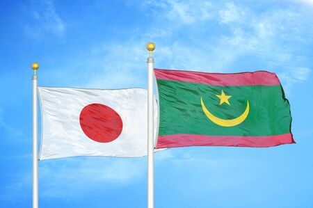 Japan and Mauritania two flags on flagpoles and blue cloudy sky background