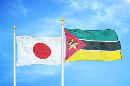 Japan and Mozambique two flags on flagpoles and blue cloudy sky background