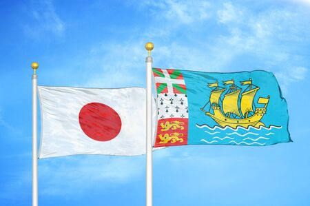 Japan and Saint Pierre and Miquelon two flags on flagpoles and blue cloudy sky background 스톡 콘텐츠