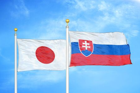 Japan and Slovakia two flags on flagpoles and blue cloudy sky background