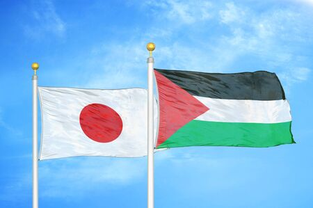Japan and Palestine two flags on flagpoles and blue cloudy sky background