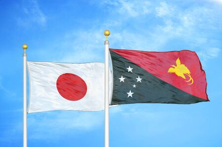 Japan and Papua New Guinea two flags on flagpoles and blue cloudy sky background 스톡 콘텐츠