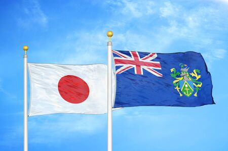 Japan and Pitcairn Islands two flags on flagpoles and blue cloudy sky background 스톡 콘텐츠