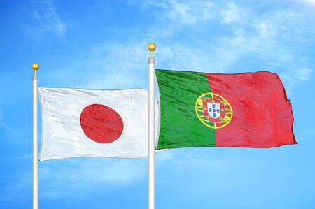 Japan and Portugal two flags on flagpoles and blue cloudy sky background 스톡 콘텐츠