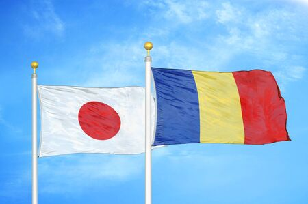 Japan and Romania two flags on flagpoles and blue cloudy sky background 스톡 콘텐츠