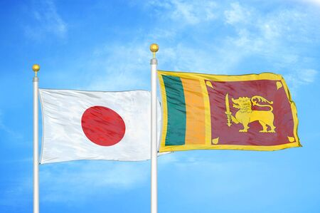 Japan and Sri Lanka two flags on flagpoles and blue cloudy sky background 스톡 콘텐츠