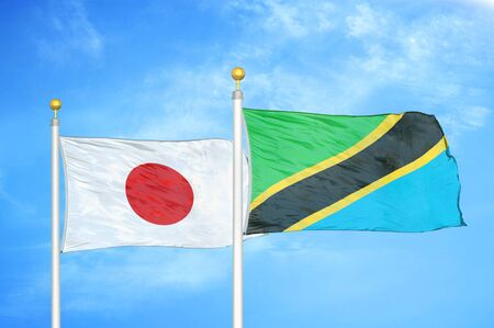 Japan and Tanzania two flags on flagpoles and blue cloudy sky background 스톡 콘텐츠