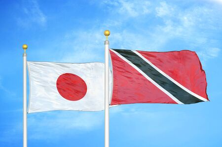 Japan and Trinidad and Tobago two flags on flagpoles and blue cloudy sky background 스톡 콘텐츠