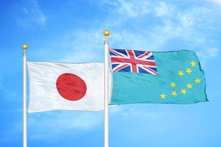 Japan and Tuvalu two flags on flagpoles and blue cloudy sky background 스톡 콘텐츠