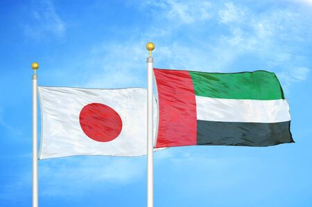 Japan and United Arab Emirates two flags on flagpoles and blue cloudy sky background 스톡 콘텐츠