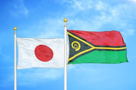 Japan and Vanuatu two flags on flagpoles and blue cloudy sky background