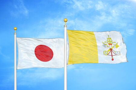 Japan and Vatican two flags on flagpoles and blue cloudy sky background