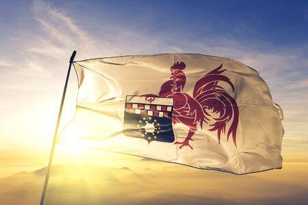 Charleroi of Hainaut of Belgium flag textile cloth fabric waving on the top sunrise mist fog