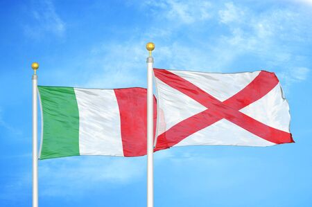 Italy and Northern Ireland two flags on flagpoles and blue cloudy sky background Stock Photo