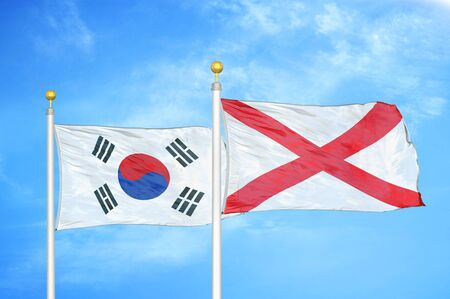 South Korea and Northern Ireland two flags on flagpoles and blue cloudy sky background Stock Photo