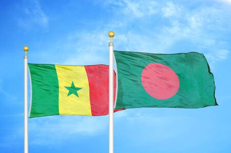 Senegal and Bangladesh two flags on flagpoles and blue cloudy sky background Stock Photo