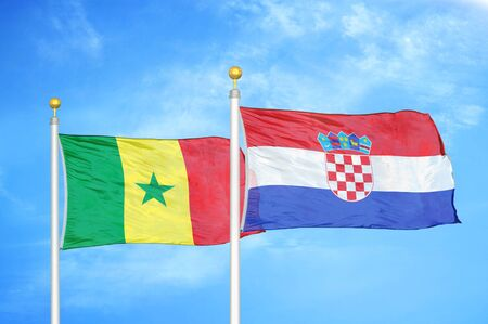 Senegal and Croatia two flags on flagpoles and blue cloudy sky background