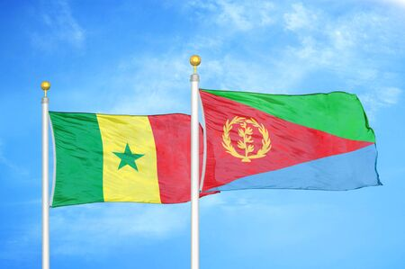 Senegal and Eritrea two flags on flagpoles and blue cloudy sky background