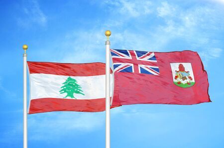 Lebanon and Bermuda two flags on flagpoles and blue cloudy sky background