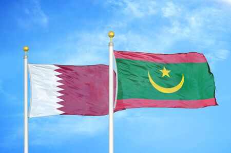 Qatar and Mauritania two flags on flagpoles and blue cloudy sky background