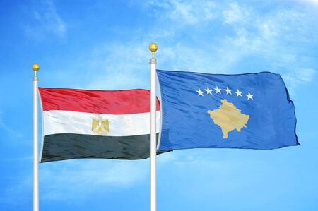 Egypt and Kosovo two flags on flagpoles and blue cloudy sky background 版權商用圖片
