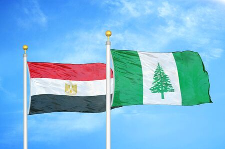 Egypt and Norfolk Island two flags on flagpoles and blue cloudy sky background