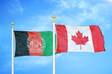 Afghanistan and Canada  two flags on flagpoles and blue cloudy sky background