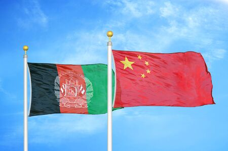 Afghanistan and China  two flags on flagpoles and blue cloudy sky background