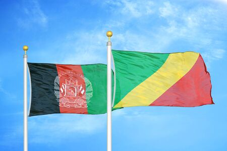 Afghanistan and Congo   two flags on flagpoles and blue cloudy sky background
