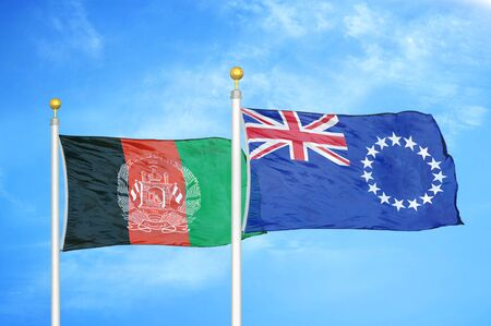 Afghanistan and Cook Islands  two flags on flagpoles and blue cloudy sky background