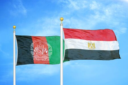Afghanistan and Egypt two flags on flagpoles and blue cloudy sky background 版權商用圖片