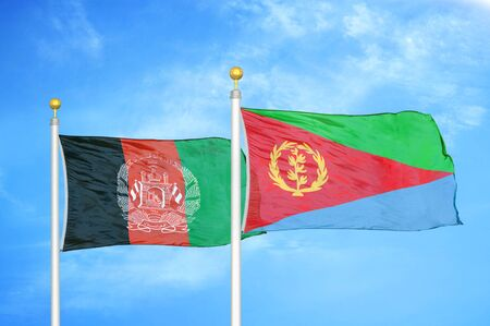 Afghanistan and Eritrea  two flags on flagpoles and blue cloudy sky background 版權商用圖片
