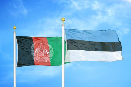 Afghanistan and Estonia  two flags on flagpoles and blue cloudy sky background 版權商用圖片