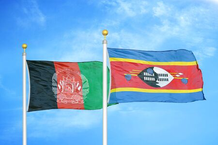 Afghanistan and Eswatini Swaziland   two flags on flagpoles and blue cloudy sky background 版權商用圖片