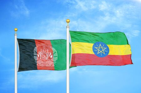 Afghanistan and Ethiopia  two flags on flagpoles and blue cloudy sky background