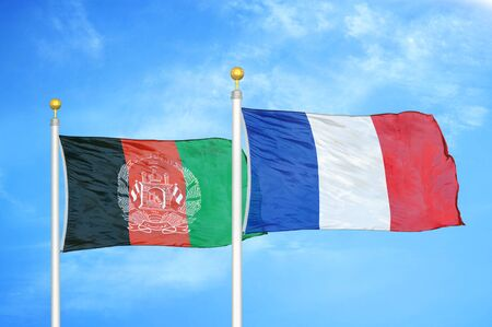 Afghanistan and France  two flags on flagpoles and blue cloudy sky background 版權商用圖片