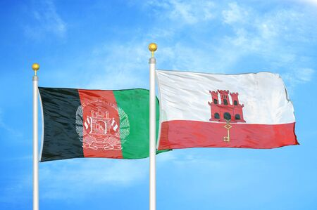Afghanistan and Gibraltar  two flags on flagpoles and blue cloudy sky background