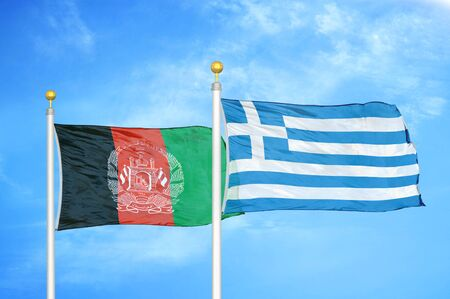 Afghanistan and Greece  two flags on flagpoles and blue cloudy sky background