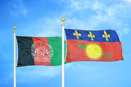 Afghanistan and Guadeloupe  two flags on flagpoles and blue cloudy sky background