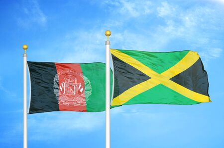 Afghanistan and Jamaica  two flags on flagpoles and blue cloudy sky background