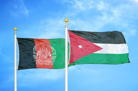 Afghanistan and Jordan  two flags on flagpoles and blue cloudy sky background