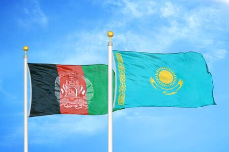 Afghanistan and Kazakhstan  two flags on flagpoles and blue cloudy sky background