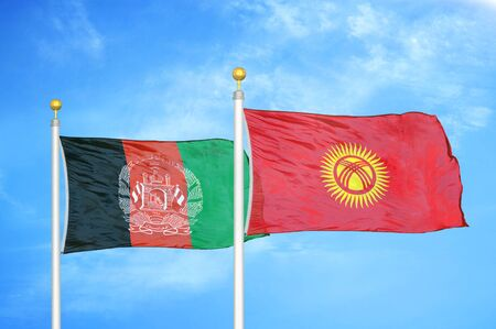 Afghanistan and Kyrgyzstan  two flags on flagpoles and blue cloudy sky background 版權商用圖片