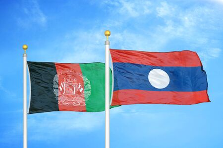 Afghanistan and Laos   two flags on flagpoles and blue cloudy sky background 版權商用圖片