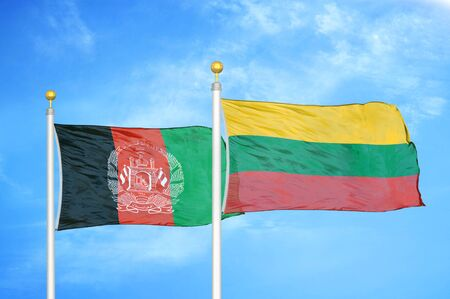 Afghanistan and Lithuania  two flags on flagpoles and blue cloudy sky background