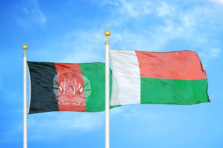Afghanistan and Madagascar  two flags on flagpoles and blue cloudy sky background 版權商用圖片