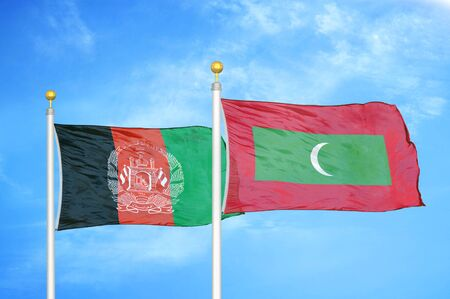 Afghanistan and Maldives  two flags on flagpoles and blue cloudy sky background