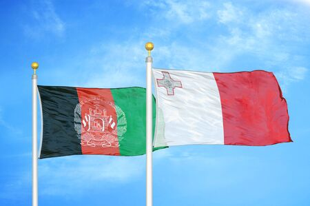 Afghanistan and Malta  two flags on flagpoles and blue cloudy sky background