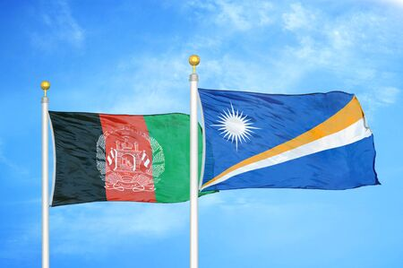 Afghanistan and Marshall Islands  two flags on flagpoles and blue cloudy sky background 版權商用圖片