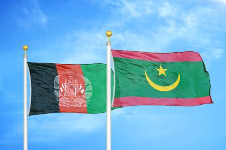 Afghanistan and Mauritania  two flags on flagpoles and blue cloudy sky background